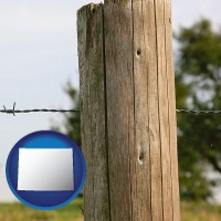 wy map icon and a fence, constructed of wooden posts and barbed wire